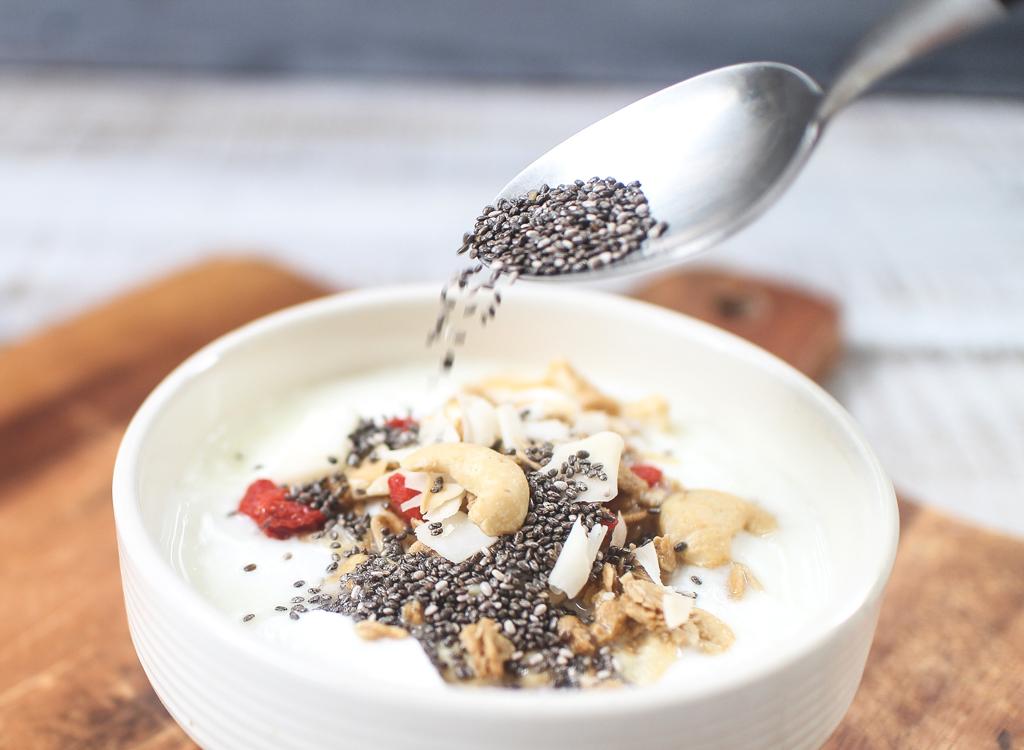 Pour chia seeds on yogurt
